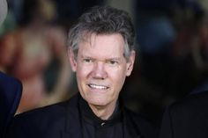 For singer Randy Travis, a long road back from stroke   Singer, wife share his progress recovering from a life-threatening stroke. Description from ux.freep.com. I searched for this on bing.com/images
