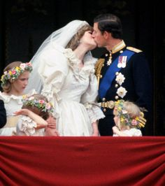 Diana and Charles First Married Smooch     0 .           They didn't know each other well at the time of their marriage, but you can't tell that from the way the new Princess of Wales gets into the couple's first post-wedding kiss on the Buckingham Palace  balcony July 29, 1981.