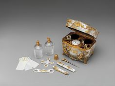 Nécessaire, 1745-50, German, mother-of-pearl and gold. Fitted with sewing and writing implements as well as a watch, this unmarked nécessaire shows delightful chinoiserie decoration in the Rococo style, echoing the work of the influential Munich designer François Cuvilliés (1695–1768).