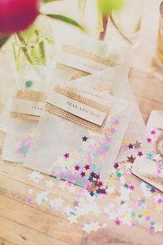 """Tear and toss"" confetti packets. Designed for a rustic wedding with burlap and lace"