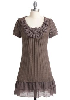 Thin sweater dress over ruffles and lots of flower applique