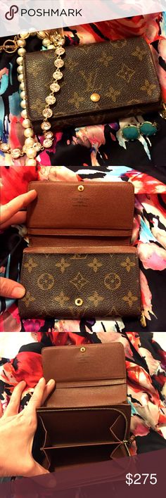 100 Authentic Louis Vuitton long wallet Used condition but authentic! Has some wear on the edge as shown. Overall a great wallet, but has been used! Louis Vuitton Bags Wallets