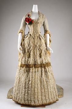 1880 British ball gown at the Metropolitan Museum of Art, New York - This piece just looks stunning!  I love the splash of colour from the flowers on the right side of the neckline.