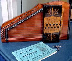 Musical/9818 A vintage Autoharp wood musical instrument with carrying case in good original condition other than needing a couple strings replaced. Description from antiquescenter2014.com. I searched for this on bing.com/images