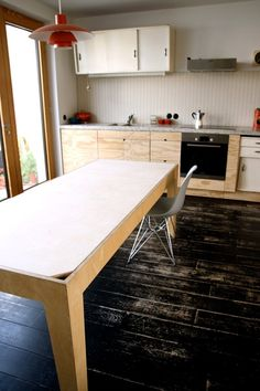 A Kitchen Table With a Surprising Storage Solution | All dining tables should have this feature.