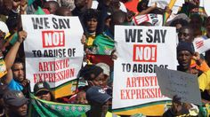 South African ruling party supporters sing during a protest in Johannesburg, South Africa on Tuesday May
