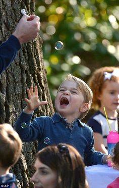 Prince George looked delighted with the bubbles at one of the activity stations