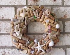 This wine cork wreath is decorated with seashells found along the Texas and Florida Gulf Coasts. Would look great on your front door or in your kitchen or bar area! This wreath is 12 inches outside diameter.
