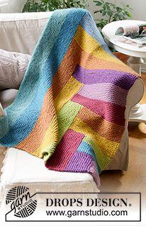 Abstract Rainbow - Gestrickte Decke in DROPS Snow. Die Arbeit wird mit Krausrippen und Streifen gestrickt. - Free pattern by DROPS Design