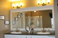 How to DIY frame a builder grade bathroom mirror...about $30 total. Lj-- this is what I was talking about for you upstairs!