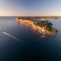 I got up way too early to get my drone out between the beautiful heads of Sydney Harbour. This is South Head at sunrise.