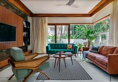 "A modern, yet tropical home set in a lush coconut plantation is the 5600 sq.ft new home for Mr. Vachan Shetty and Mrs Rashmi Shetty. The house is reminiscent of ""Guthu mane"", a traditional Mangalorean House, though with a modern twist. Small Living Room Decor, House Design, Living Room Sets, Home, Room Interior Design, Tropical Houses, Trendy Interior Design, Living Room Decor, Rugs In Living Room"