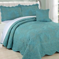 Add a pop of pattern to the master suite or guest room with this lovely quilt set, featuring a chic embroidered damask motif.