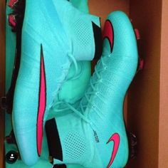 Blue and pink soccer cleats