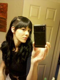 like the bangs across w/ side shave   http://tattoosandpowersuits.blogspot.com/2011/07/for-lack-of-better-photo.html