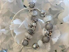 PANDORA Bracelet and Bangle Showcasing Beautiful White and Silver Charms :-)
