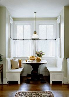 Breakfast nook--love the idea of something like this in the kitchen, when you dont want to use the dining room.