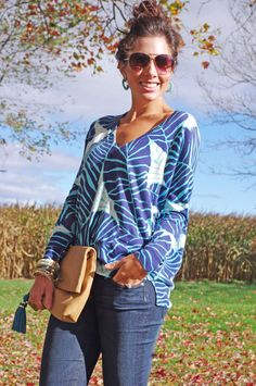 Lilly Pulitzer Eleni Sweater & Worth It Leather Clutch worn by Brynn There Worn That