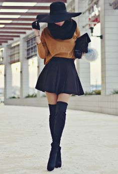 Super cute skater skirt extra frills gold yellow sweater over the knee black felt books with a cotton black scarf and a wide brim hat. Black clutch and leather gloves