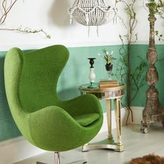 Interior Trends for 2016 - Egg chair, £455, Two tone glass and bronze candle sticks, £77 per pair, Giant floor-standing candle stick, £199, Sheepskin rug, £149, Antiqued Venetian side table, £295, White beaded chandelier, £729, All outthereinteriors.com