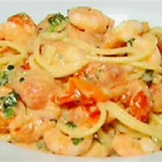 Try this Spaghetti with prawns in a creamy tomato sauce recipe by Chef Gordon Ramsay. This recipe is from the show The F Word.