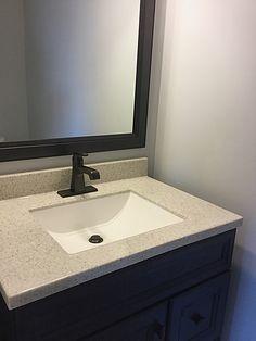 Single vanity in half bath.