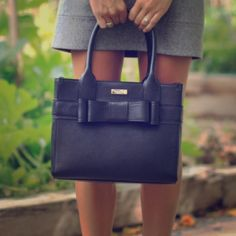 Kate spade new Black Bow Back Handbag Like new , without a flaw , this Kate spade handbag is an absolute classic! Shell is 100% leather 100% polyester lining. I LOVE this purse & want someone to enjoy it too kate spade Bags