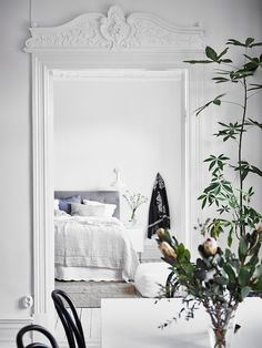 Period features and plants in a magnificent white Swedish apartment