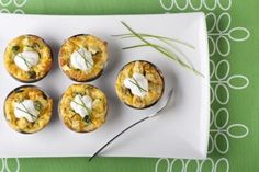 Mini quiche appetizers with sour cream and chives