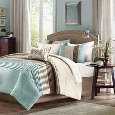 A modern twist to a classic color block bed. Belleview is made from a faux silk texture with pleating details to give it an update to a classic look. Features colors of sky blue, tan and brown.