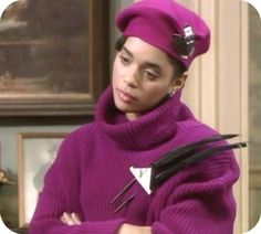Huge brooches with feathers: | Community Post: 23 Looks That Only Denise Huxtable Can Pull Off