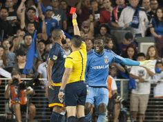 An official issues a red card to Galaxy defender Leonardo, left, during the second half against the Earthquakes in San Jose. Down a player, Los Angeles lost 1-0.  Ed Szczepanski, USA TODAY Sports