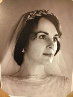 Michelle Dockery as Lady Mary in Downton Abbey wearing the tiara of Bentley & Skinner.