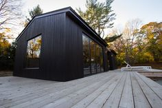 General Assembly specified our MONOGATARI shou sugi ban charred cypress exterior siding for this unique Shelter Island, NY pool house Wood Siding, Exterior Siding, Exterior Design, Interior And Exterior, Cedar Siding, Interior Cladding, Timber Cladding, House Noir, Pool House Designs