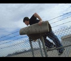 How to get over barbed wire fence.
