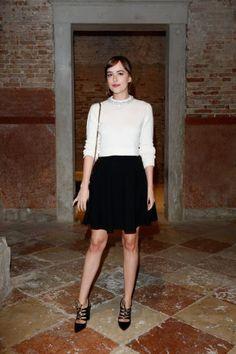 Dakota Johnson wears an elegantly simple Miu Miu ensemble. See more of Venice Film Festival's best dressed here: