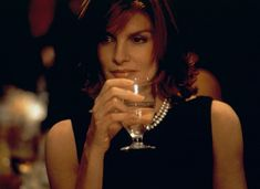 Rene Russo as Catherine Banning in Thomas Crown Affair - She Got Style | DAILY DOSE | Movie Fashion Icons