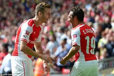 All smiles: Calum Chambers goes over to congratulate the playmaker after he found the net