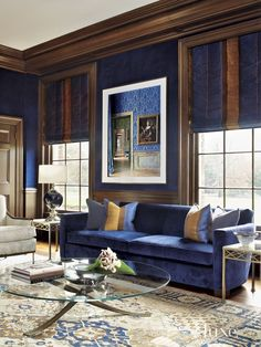 These spaces prove that a splash of dark blue makes a serious statement.