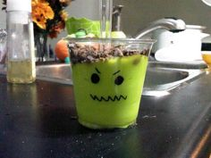 vanilla pudding coloured with neon food dye, oreo cookes crumbled on top. Great for a class or halloween party