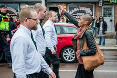 Tess Asplund, the woman who was photographed in this iconic snap standing up to 300 neo-Nazis at a Swedish far-right rally.