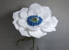 White Poppy Made of Felt - White Flower - Artificial Flower - Fake Flower - Artificial Poppy - Fake Poppy - Felt Poppy. This is a beautiful flower made of felt that lasts forever! It looks great in a vase by itself or as part of a bouquet. The stem is made of a floral wire, so it is stable but bendable. Price is for one flower. If you want another color, please check my shop. If you don't see the color you want there, please message me. I have many different colors of felt.