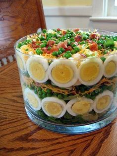 seven layer salad in trifle bowl