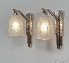 MULLER FRERES : Pair of French 1930 art deco wall sconces. These stunning wall lights in nickel plated solid brass hold 2 beautiful Muller shades . White frosted moulded-pressed glass, both signed Muller freres Luneville. (paravas-ebay)
