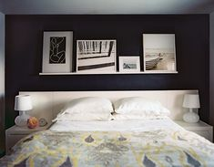 Black walls, framed art, and white bedding in a bedroom Details: Black-Yellow Minimalist-Modern Bedroom Keywords: July August 2011 Issue, Wall Art, Art On Shelf, Ikat, Lisa Stasiulewicz, Headboard (Source: Lonny)