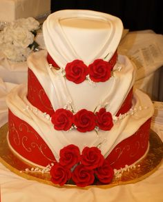 Red, White and Gold Morocco Wedding Cake, roses, baby's breath, fondant drapes. www.cakedesigners.net