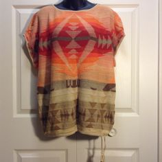Aztec style woman's top Aztec style woman's  short sleeve sweater missing size tag but is a XL  orange ,red ,tan and brown Ralph Lauren Sweaters
