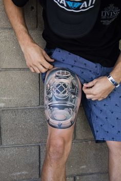 Helmet tattoo done by Monte Livingston on his own thigh with Living Art Gallery Tattoo Lounge in San Clemente, CA Won best tattoo of the day at Body Art Expo in San Diego @monte_livingston @livingartgallery