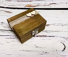 Wooden rustic box for wedding rings. Inside box a sponge with burlap. Lid decorated with cotton lace and lacer cut plywood decor - butterfly, small hearts or bigger heart. On big heart some writings can be placed. ON ORDER - takes approx. one week to be made External dimensions: 10x8x5,2 cm (4x3x2) Of course write to me is you have any question or want some custom order - Ill be happy to make something special for you. Please note: Please check dimensions carefully. Due to lighting condit...