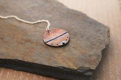 The copper has been heated, folded, hammered and textured. I've added the fine silver as a bright accent. Each piece of jewelry is made individually so please allow for slight...